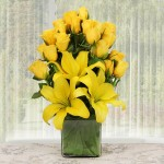 20 yellow rose and 3 yellow lilies