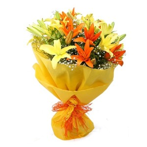 yellow and orange lillies hand bunch